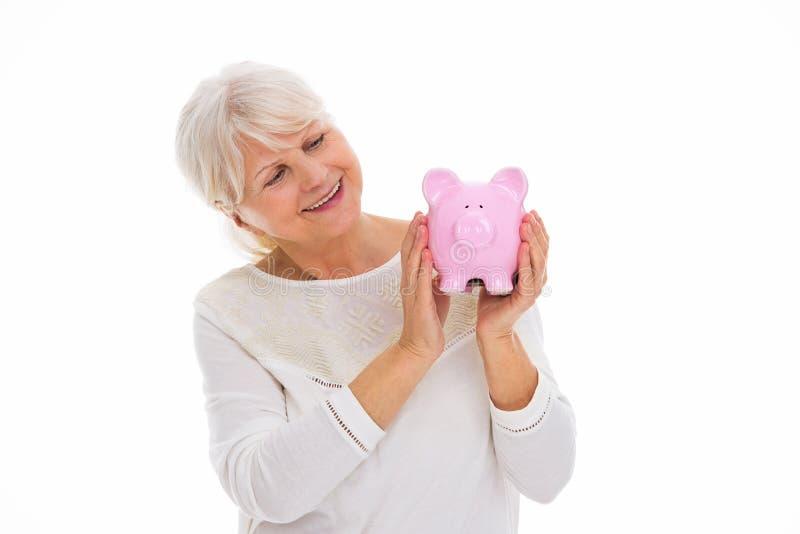 banka mienia prosiątka seniora kobieta zdjęcie royalty free