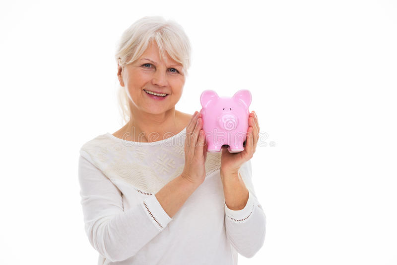 banka mienia prosiątka seniora kobieta fotografia royalty free