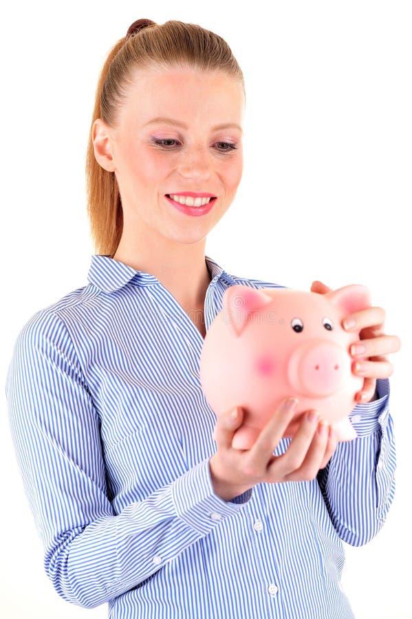 banka przyglądająca prosiątka kobieta obrazy stock