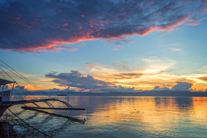 Banka, traditional filipino fishing boat at sunset, Cebu island The Philippines. Banka, traditional filipino fishing boat at sunset, Cebu island, The Philippines royalty free stock image