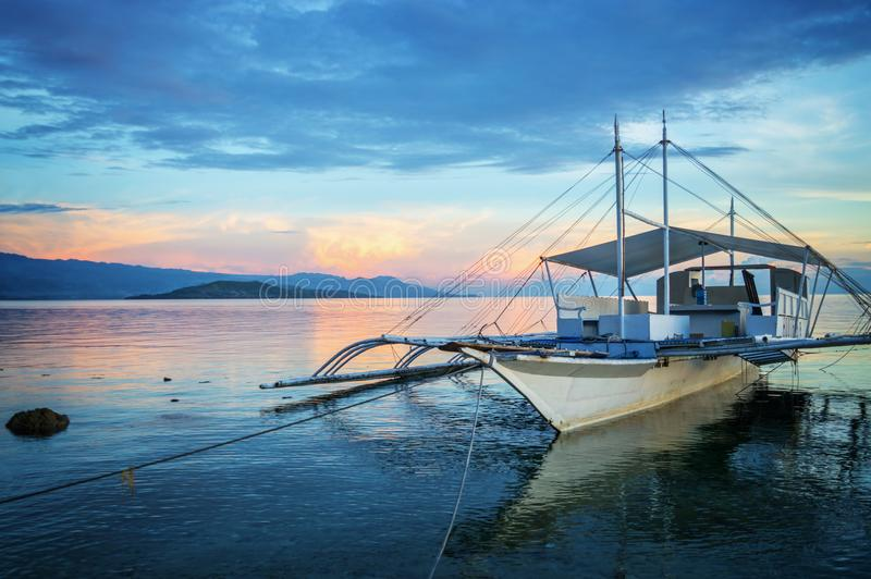 Banka, traditional filipino fishing boat at sunset, Cebu island, The Philippines. Banka, traditional filipino fishing boat at sunset, Cebu island in The royalty free stock image