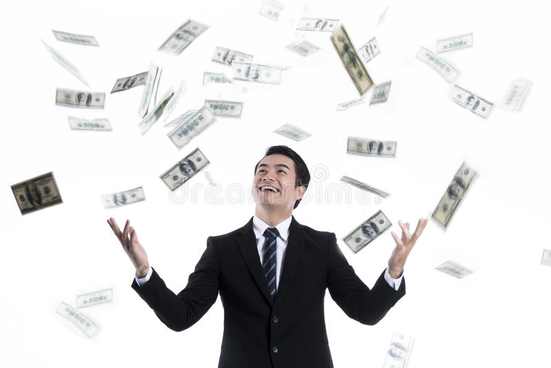 Bankbiljet die over jonge zakenman vallen royalty-vrije stock foto