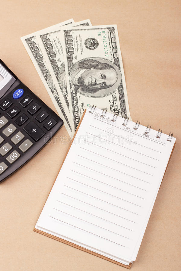 Bankbiljetten, blocnote, calculator royalty-vrije stock afbeeldingen