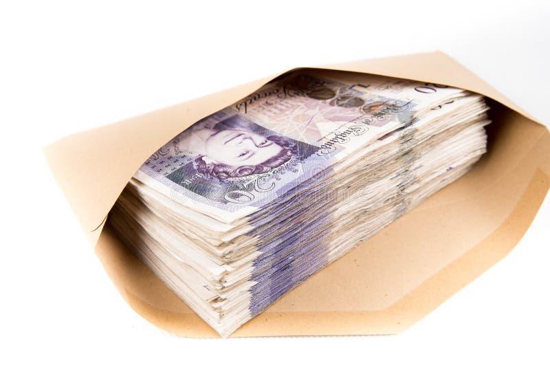 Bankbiljetten in envelop stock afbeeldingen