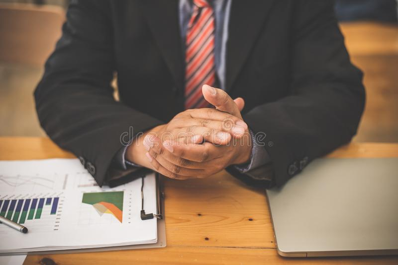 Banker business man working graph data supply and demand market royalty free stock image