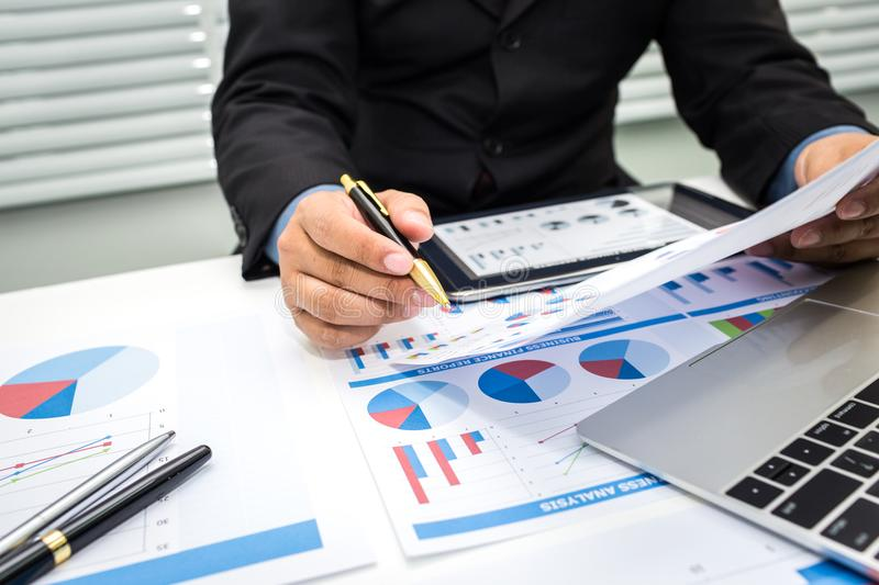 Bankers are analyzing financial data. To sum up the deposit and withdraw daily royalty free stock photos