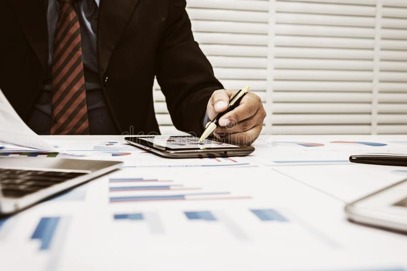 Bankers are analyzing financial data. To sum up the deposit and withdraw daily royalty free stock photo