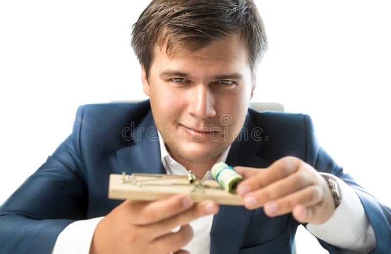 Bankier die risicodragende investering aanbieden Het muizeval van de mensenholding met mon royalty-vrije stock afbeelding