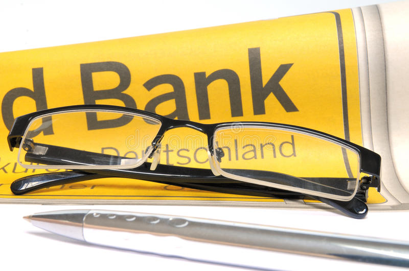 Banking. Glasses and ball point in front of a lettering Bank royalty free stock image