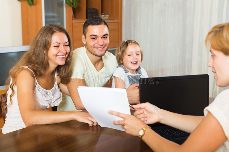 Banking assistant and satisfied family stock photos