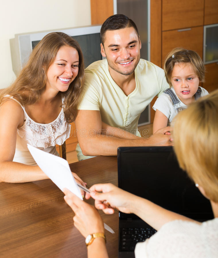 Banking assistant and satisfied family royalty free stock image