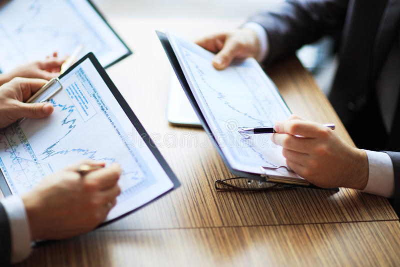 Banking business or financial analyst desktop accounting charts stock photography