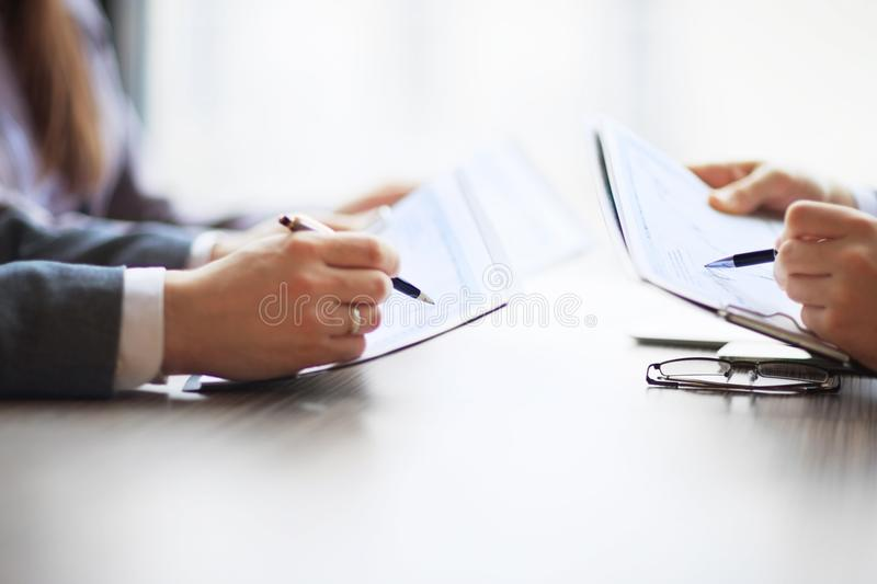 Banking business in financial analyst desktop accounting charts, pens indicates graphics. Banking business or financial analyst desktop accounting charts, pens stock image