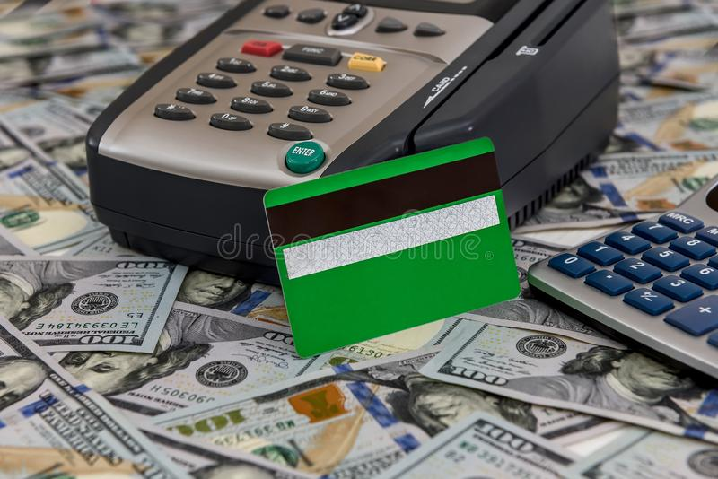 Banking terminal with green credit card and dollar background.  stock photo