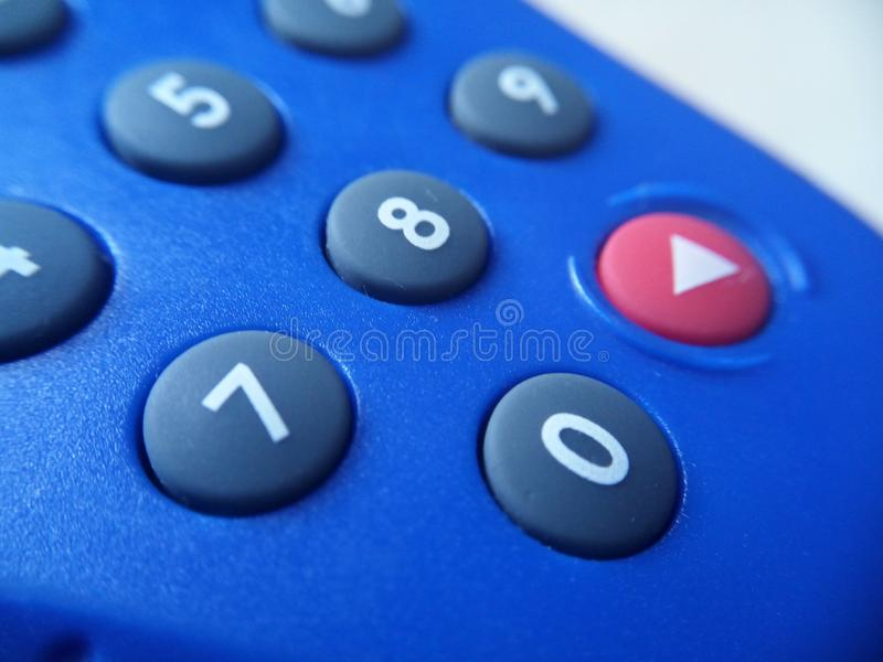 Banking token device in closeup look showing number keys and the red enter button. Button, keypad, phone, buttons, remote, control, telephone, numbers royalty free stock images
