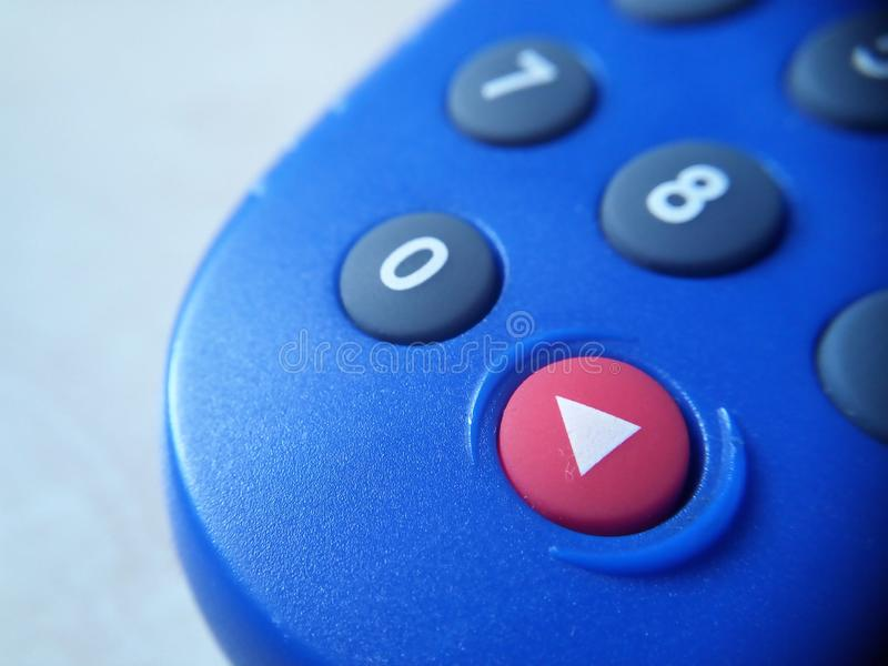 Banking token device in closeup look showing number keys and the red enter button. Button, keypad, phone, buttons, remote, control, telephone, numbers stock photography