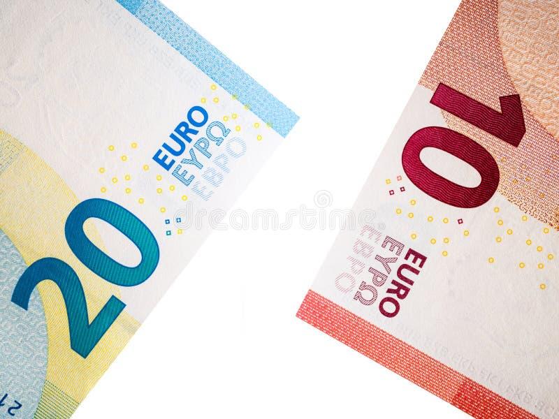 Banknote des Euros zehn und zwanzig auf weißem Hintergrund lizenzfreie stockfotos