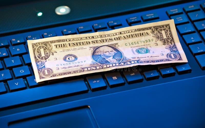 Banknote on keyboard stock image