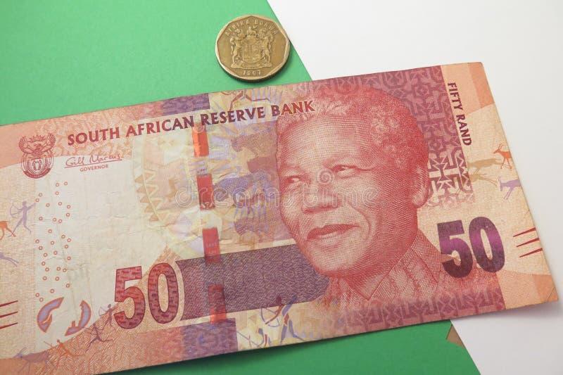 Banknote und Münze des südafrikanischen Rands lizenzfreie stockfotos