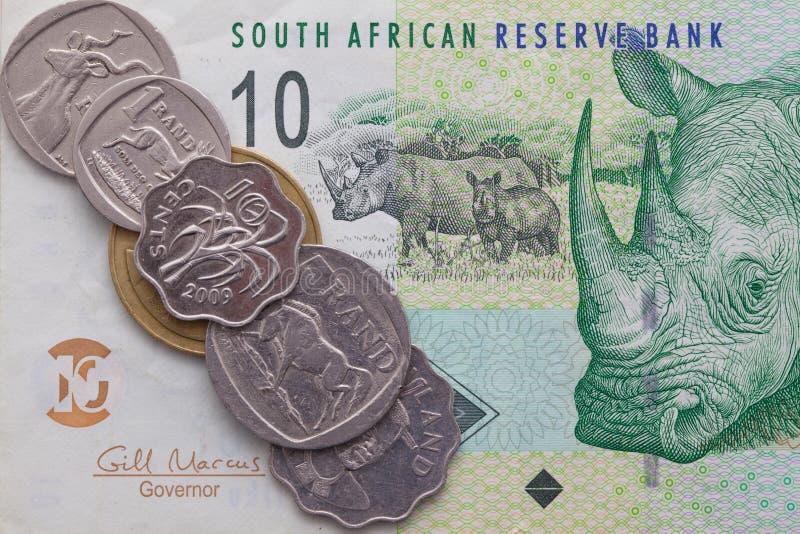 Banknote und Münzen des Rands von Südafrika stockbilder