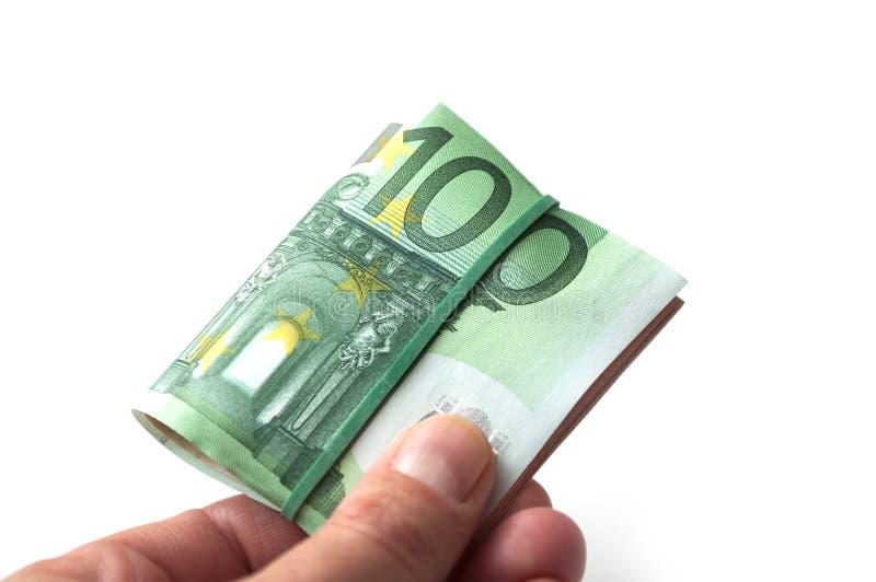 Banknotenbündel von hundert Eurogeld in der Hand auf wh stockbilder