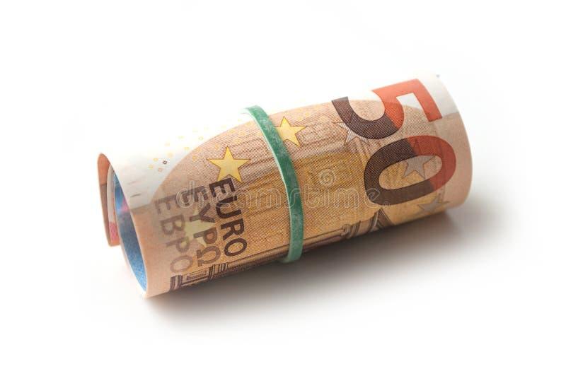 Banknotenrolle des fünfzig-Euro-Geldes auf weißem backgrou lizenzfreie stockfotos