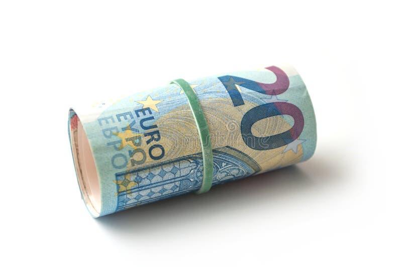 Banknotenrolle des zwanzig-Euro-Geldes auf weißem backgro stockbilder
