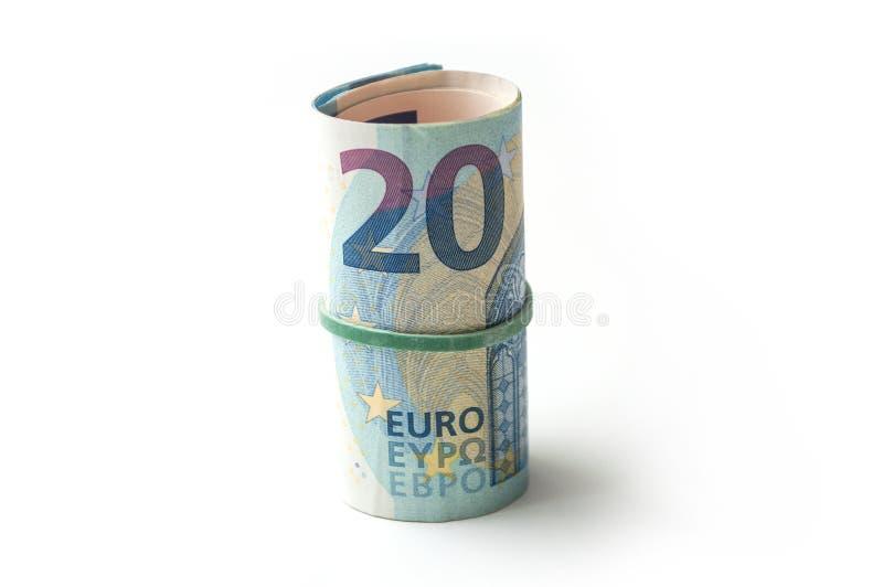 Banknotenrolle des zwanzig-Euro-Geldes auf weißem backgro lizenzfreie stockbilder
