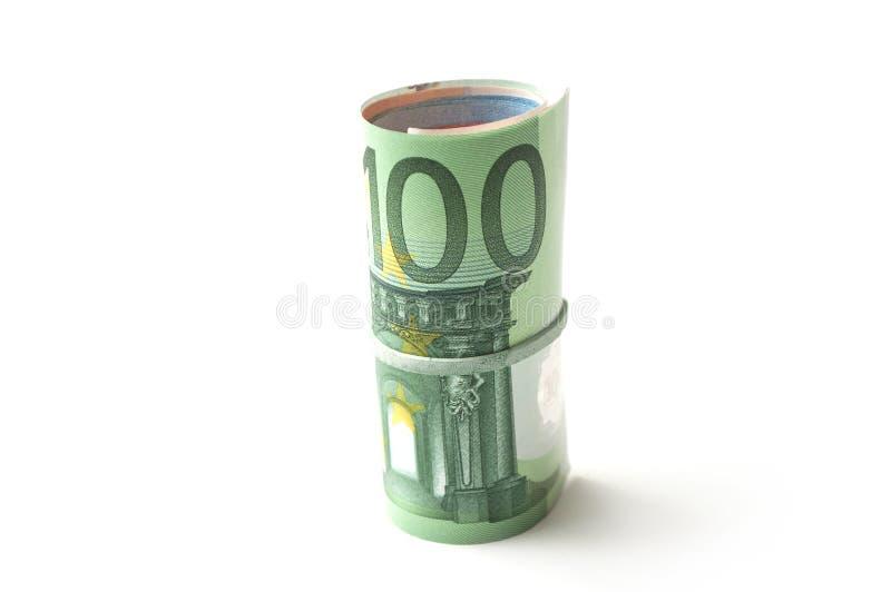 Banknotenrolle von hundert Eurogeld auf weißem Ba stockbilder
