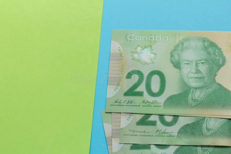 Banknotes of Canadian currency: Dollar. Bills on colorful bright table. Banknotes of Canadian currency: Dollar. Canada Money. Bills on colorful bright table stock image