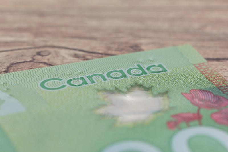 Banknotes of Canadian currency: Dollar. Bils on wood rustic table. Banknotes of Canadian currency: Dollar. Canada Money. Bils on wood rustic table stock photos