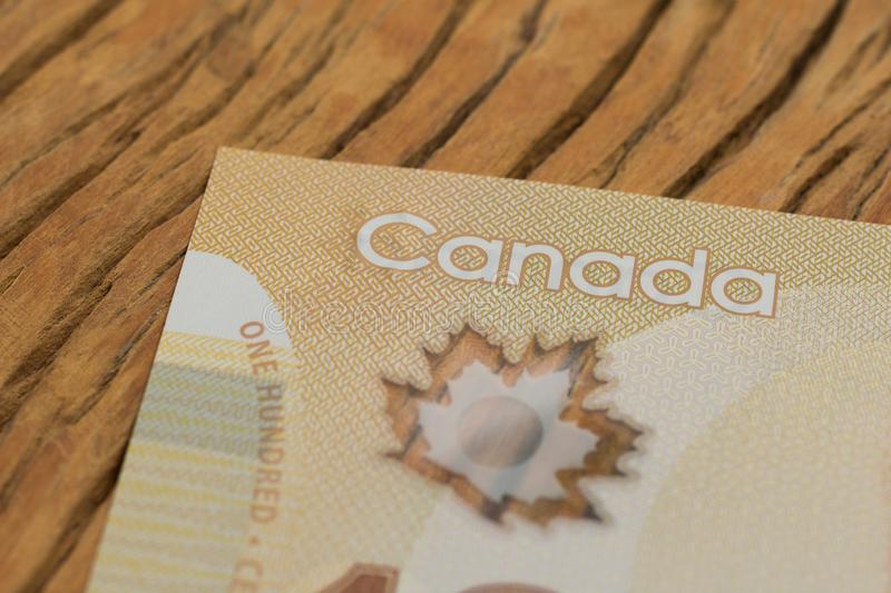 Banknotes of Canadian currency: Dollar. Close up of cash bills on rustic wood table. Banknotes of Canadian currency: Dollar. Canada Money. Close up of cash bills royalty free stock photography