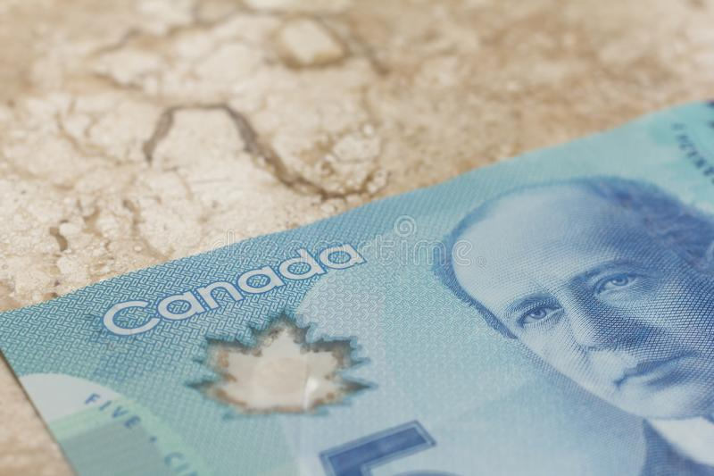 Banknotes of Canadian currency: Dollar. Closeup on marble table. Banknotes of Canadian currency: Dollar. Canada Money. Closeup on marble table royalty free stock photo