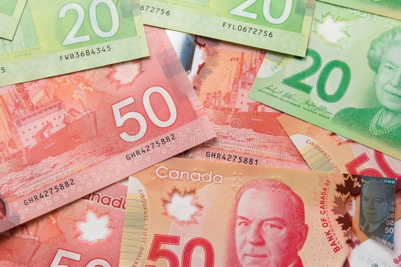 Banknotes of Canadian currency: Dollar. Full frame of bills spread on table and assorted amounts. Banknotes of Canadian currency: Dollar. Canada Money. Full royalty free stock photography