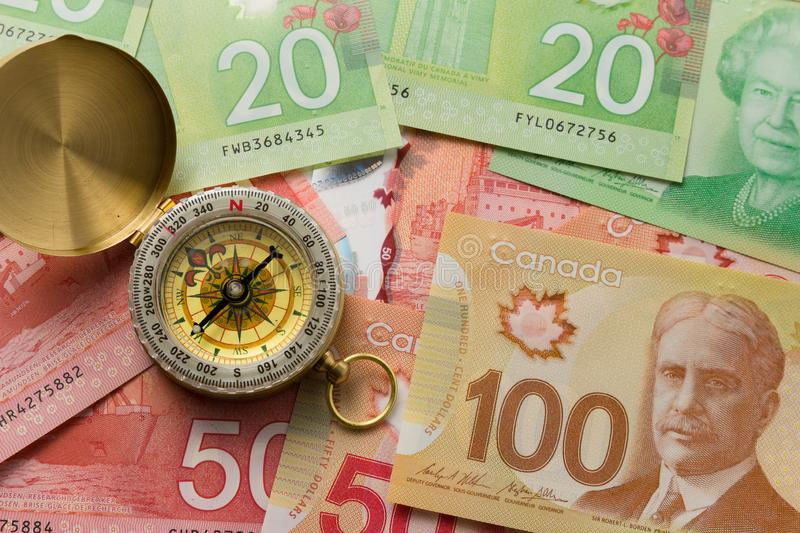 Banknotes of Canadian currency: Dollar. Full frame of bills spread on table and assorted amounts. Banknotes of Canadian currency: Dollar. Canada Money. Full royalty free stock photo