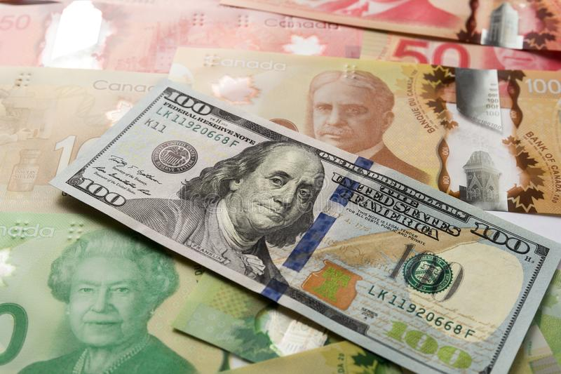 Banknotes of canadian currency: Dollar and North American Currency: US Dollars. Full frame of bills spread on table and assorted. Amounts royalty free stock photos