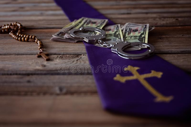 Banknotes and catholic church symbols. Church and money royalty free stock photo