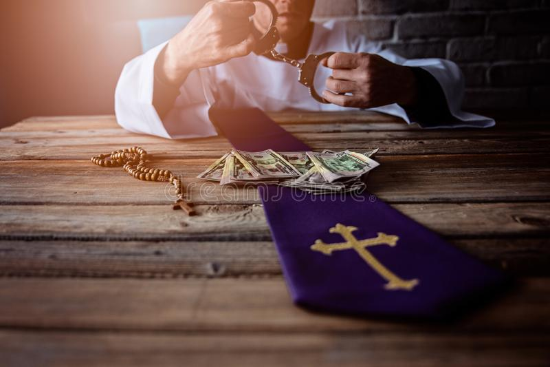 Banknotes and catholic church symbols. Church and money stock photo