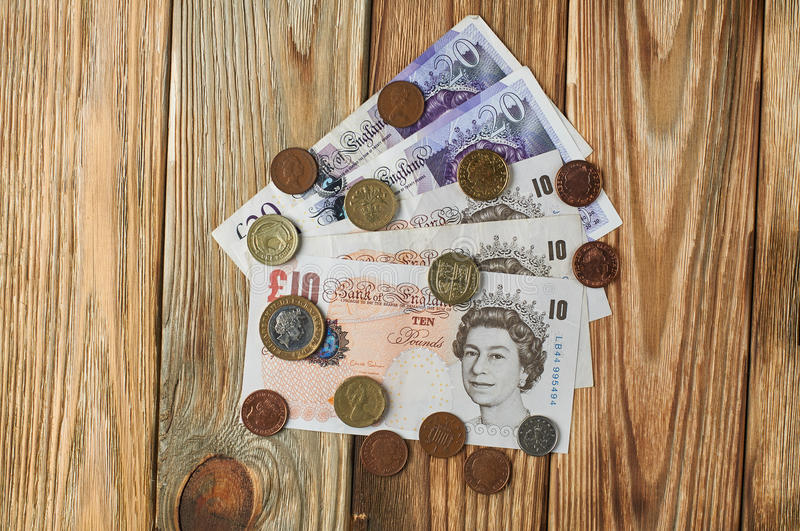 Banknotes and coins from the United Kingdom. stock photography