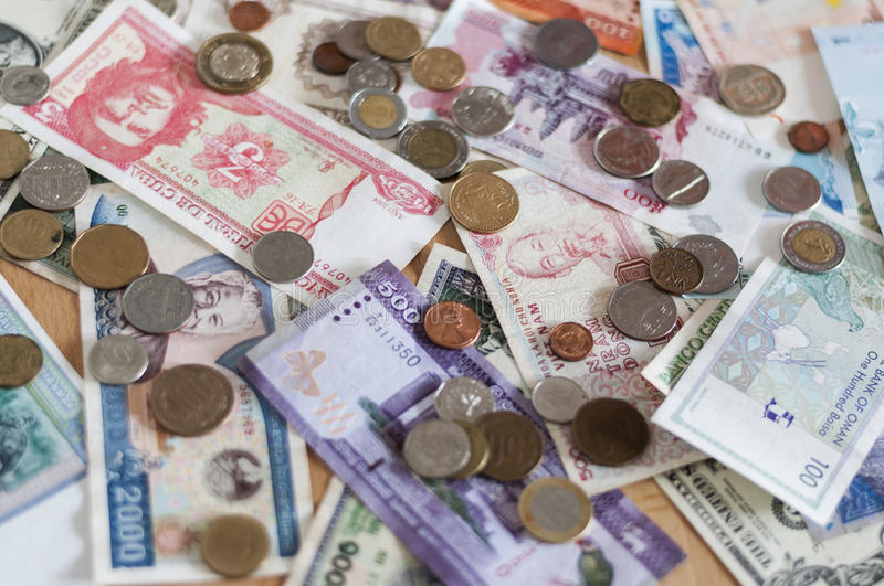 Banknotes and Coins. Various bills and coins from different countries royalty free stock photos