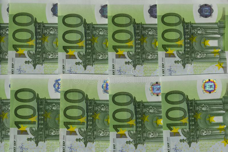 Banknotes 100 euros beautifully laid out. Euro euro money. Background, banking, bills, bucks, burse, business, cash, close-up, currency, denomination, deposit royalty free stock photo