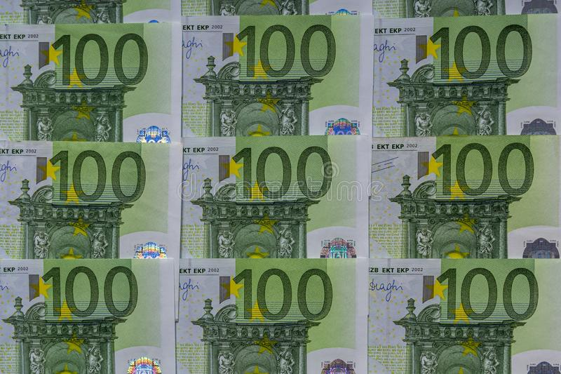 Banknotes 100 euros beautifully laid out. Euro euro money. European Union banking, financial savings. Background, business, bills, bucks, burse, cash, close-up royalty free stock photography