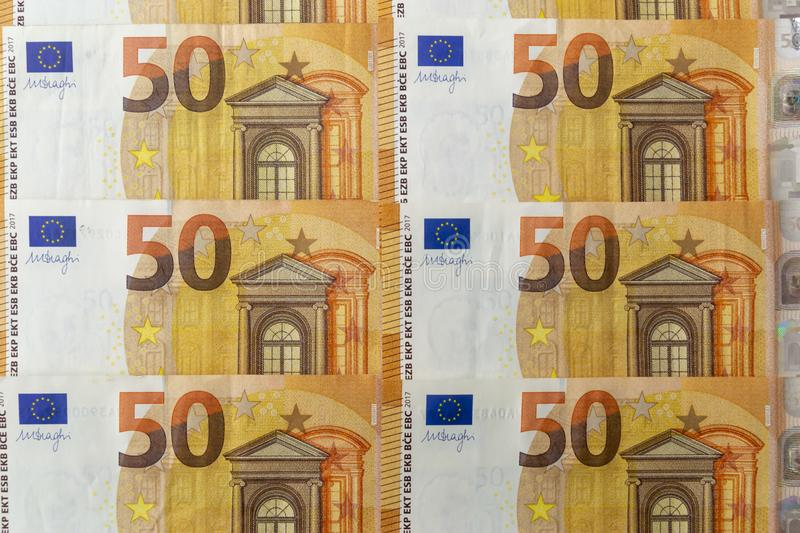 Banknotes 50 euros beautifully laid out. Euro notes background on a long banner. Beautiful original cash flow. Accumulation, banking, bill, bills, business royalty free stock photos