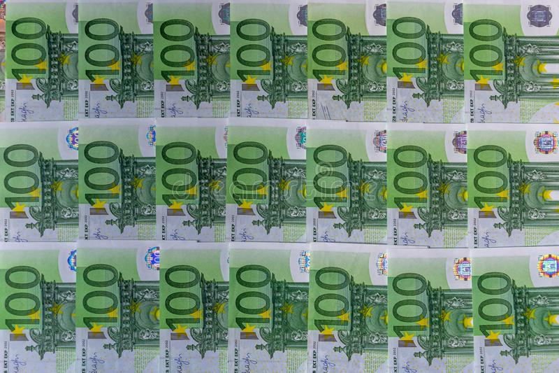 Banknotes 100 euros euro money beautifully laid out. Top view background texture. Banking, bills, bucks, burse, business, cash, close-up, currency stock image
