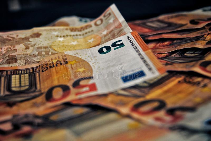 Banknotes of 50 euros. Photo of fifty euro banknotes placed on top of each other. Background, cash, euros, money royalty free stock photos