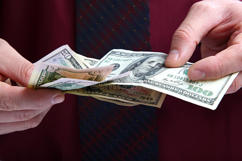 Banknotes in the hands of a businessman stock photos