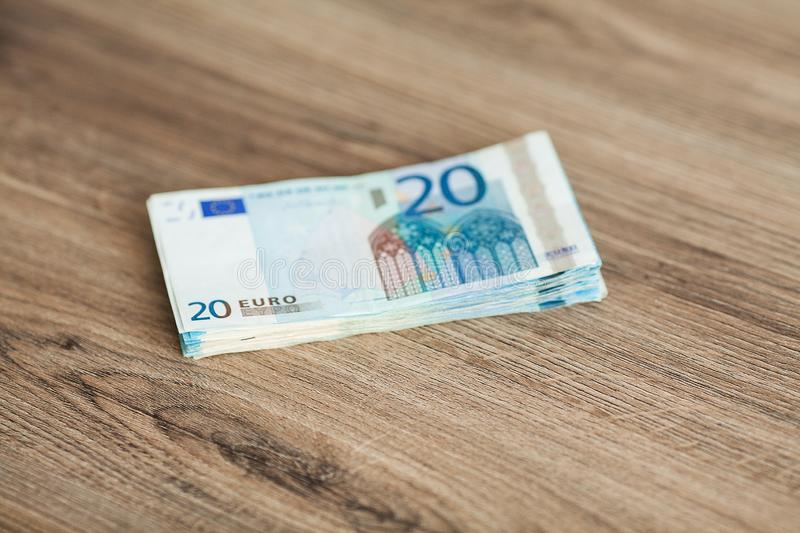 Banknotes with a nominal value of twenty Euro lying like a fan on the table.  royalty free stock photo