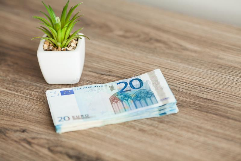 Banknotes with a nominal value of twenty Euro lying like a fan on the table.  stock image