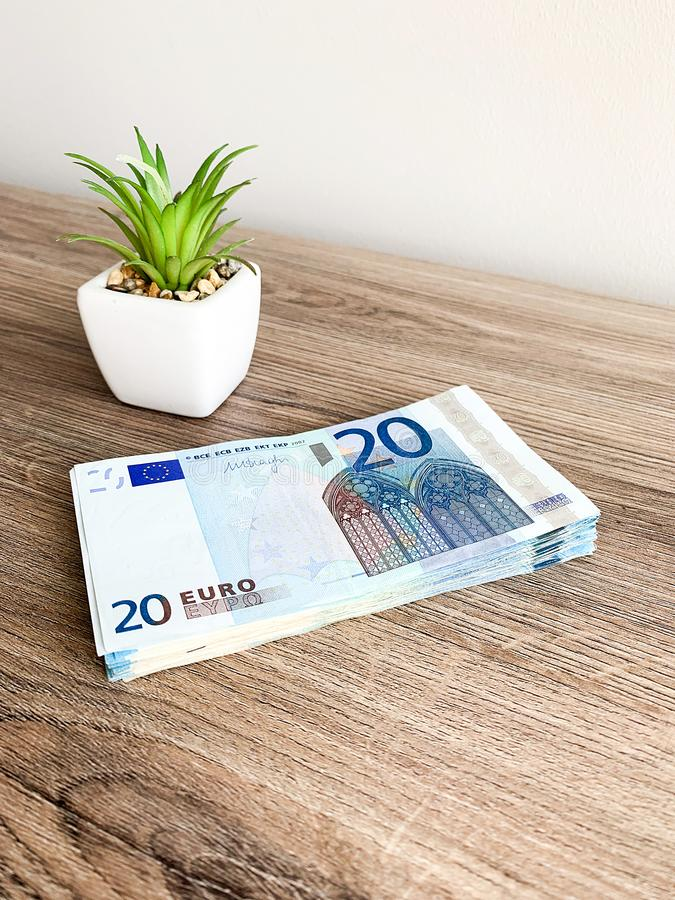 Banknotes with a nominal value of twenty Euro lying like a fan on the table.  stock photography