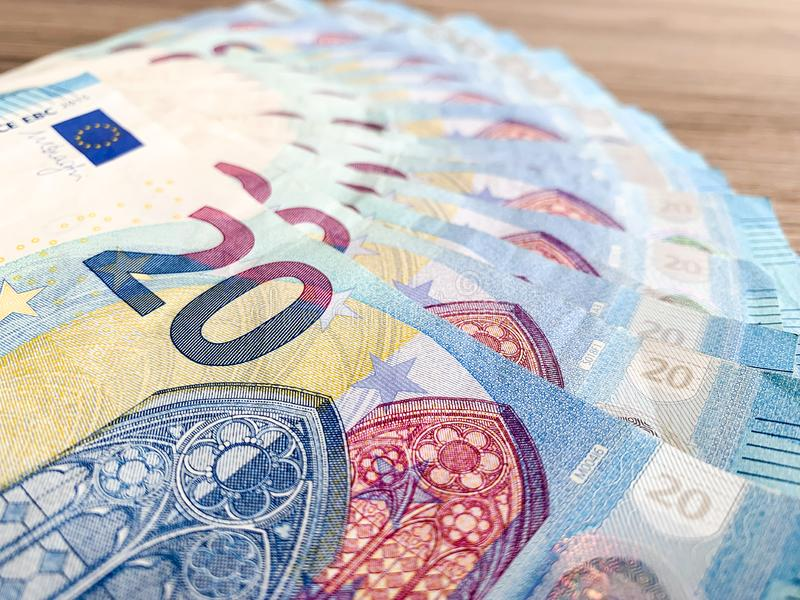 Banknotes with a nominal value of twenty Euro lying like a fan on the table.  stock photo